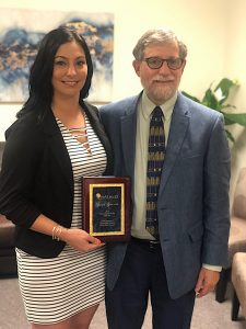 NAFI CT Clinical Social Worker Stacey Shaia accepting her award from Steve Kara, executive director of NASW CT.